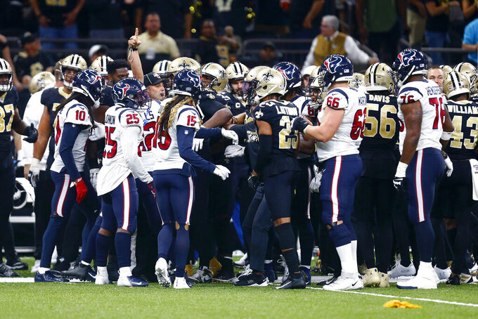 New Orleans Saints and Houston Texans scuffle after an interception by the Saints in the second half of an NFL football game in New Orleans, Monday, Sept. 9, 2019. (AP Photo/Butch Dill)