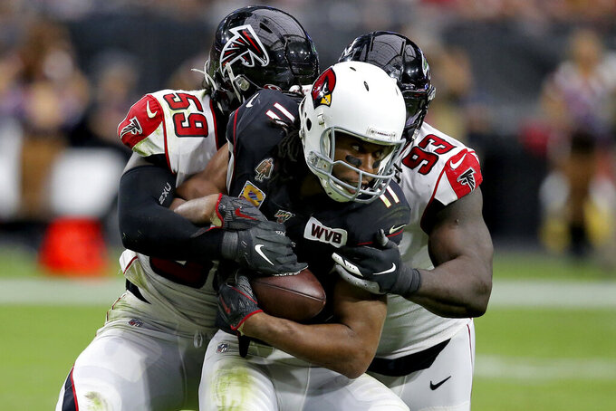 Arizona Cardinals wide receiver Larry Fitzgerald (11) is hit by outside linebacker De'Vondre Campbell (59) anduring the second half of an NFL football game, Sunday, Oct. 13, 2019, in Glendale, Ariz. (AP Photo/Ross D. Franklin)