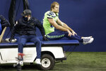 Seattle Seahawks tight end Greg Olsen (88) is taken off the field on a cart after going down with an injury against the Arizona Cardinals during the second half of an NFL football game, Thursday, Nov. 19, 2020, in Seattle. (AP Photo/Lindsey Wasson)