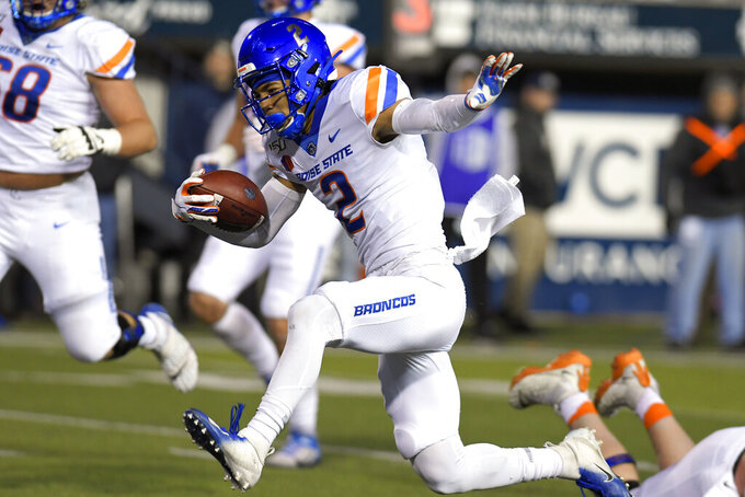 Boise State wide receiver Khalil Shakir (2) runs into the end zone for a 14-yard touchdown against Utah State during the first half of an NCAA college football game Saturday, Nov. 23, 2019, in Logan, Utah. (AP Photo/Eli Lucero)
