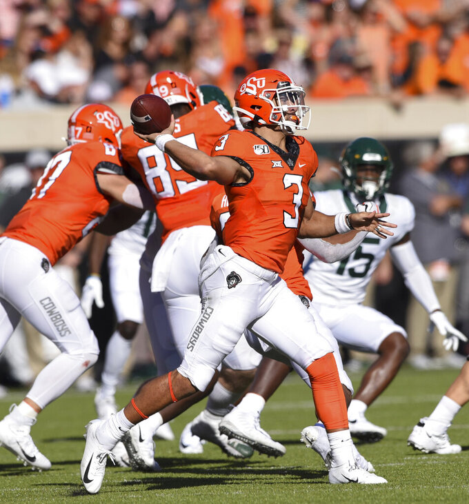Oklahoma State quarterback Spencer Sanders (3) throws a pass during the first half of an NCAA college football game against Baylor in Stillwater, Okla., Saturday, Oct. 19, 2019. (AP Photo/Brody Schmidt)