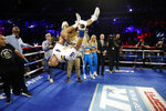 FILE  - In this Dec. 14, 2019, file photo, Teofimo Lopez flips in the ring after defeating Ghana's Richard Commey by TKO during the second round of an IBF lightweight boxing match, in New York. Brooklyn-born Teofimo Lopez stunned Vasiliy Lomachenko on Saturday, Oct. 17, 2020, to win a unanimous 12-round decision and unify the lightweight titles to join a rare group of boxers of Central American descent to capture a world championship.(AP Photo/Michael Owens, File)