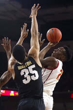 Southern California forward Onyeka Okongwu, right, shoots under as Colorado forward Dallas Walton defends during the first half of an NCAA college basketball game Saturday, Feb. 1, 2020 in Los Angeles. (AP Photo/Kyusung Gong)