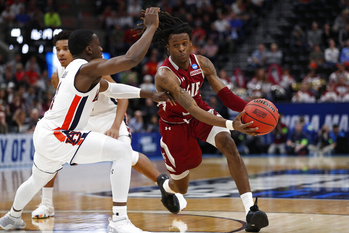 Auburn's guard Jared Harper, left, defends against New Mexico State guard Terrell Brown, right, in the first half during a first round men's college basketball game in the NCAA Tournament, Thursday, March 21, 2019, in Salt Lake City. (AP Photo/Jeff Swinger)