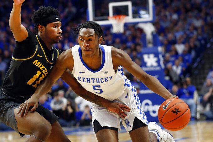 Kentucky's Immanuel Quickley (5) drives on Missouri's Mario McKinney Jr. (11) during the second half of an NCAA college basketball game in Lexington, Ky., Saturday, Jan 4, 2020. Kentucky won 71-59. (AP Photo/James Crisp)