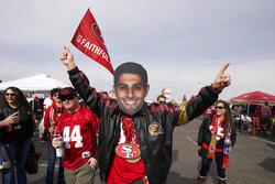 A San Francisco 49ers fan wears a mask of quarterback Jimmy Garoppolo while tailgating at Levi's Stadium before the NFL NFC Championship football game between the 49ers and the Green Bay Packers Sunday, Jan. 19, 2020, in Santa Clara, Calif. (AP Photo/Tony Avelar)