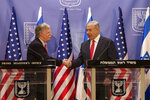 Israeli Prime Minister Benjamin Netanyahu, right, shakes hands with U.S. National Security Advisor John Bolton in Jerusalem, Sunday, June 23, 2019. (AP Photo/Tsafrir Abayov, Pool)