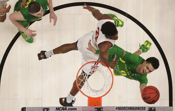 Oregon guard Will Richardson (0) shoots against Wisconsin guard Khalil Iverson during the second half of a first round men's college basketball game in the NCAA Tournament, Friday, March 22, 2019, in San Jose, Calif. (AP Photo/Ben Margot)