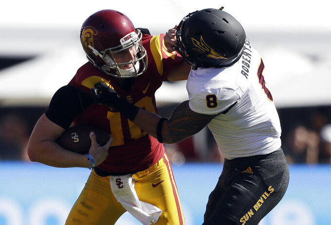 Southern California quarterback Jack Sears, left, is tackled by Arizona State linebacker Merlin Robertson during the first half of an NCAA college football game Saturday, Oct. 27, 2018, in Los Angeles. (AP Photo/Marcio Jose Sanchez)
