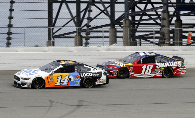 Clint Bowyer, left, and Kyle Busch compete during a NASCAR Cup Series auto race at Chicagoland Speedway in Joliet, Ill., Sunday, June 30, 2019. (AP Photo/Nam Y. Huh)