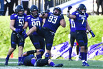 Northwestern defensive lineman Joe Spivak (93) reacts with linebacker Blake Gallagher (51), defensive tackle Jake Saunders (90) and defensive back Travis Whillock (7) after he sacks UNLV quarterback Armani Rogers during the second half of an NCAA college football game, Saturday, Sept. 14, 2019, in Evanston, Ill. (AP Photo/Matt Marton)