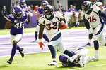 Denver Broncos running back Javonte Williams (33) tries to break a tackle by Minnesota Vikings defensive end D.J. Wonnum, right, during the first half of an NFL preseason football game, Saturday, Aug. 14, 2021, in Minneapolis. (AP Photo/Jim Mone)
