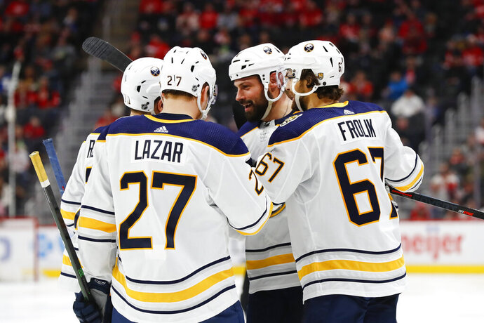 Buffalo Sabres defenseman Zach Bogosian, second from right, celebrates his goal with teammates in the third period of an NHL hockey game against the Detroit Red Wings, Sunday, Jan. 12, 2020, in Detroit. (AP Photo/Paul Sancya)