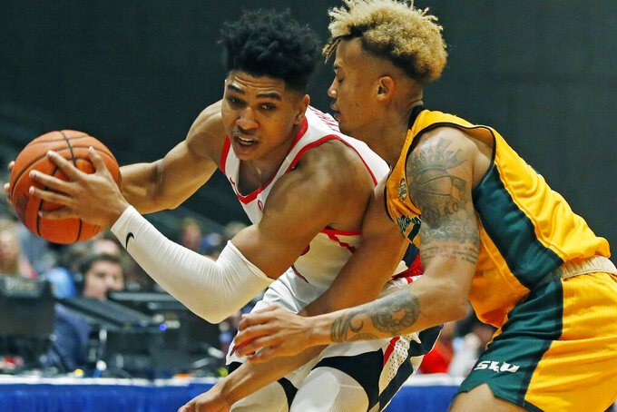 Mississippi guard Breein Tyree (4) tries to push past Southeastern Louisiana guard Isiah Kirby (2) during the second half of an NCAA college basketball game, Saturday, Dec. 21, 2019, in Jackson, Miss. Mississippi won 83-76.(AP Photo/Rogelio V. Solis)