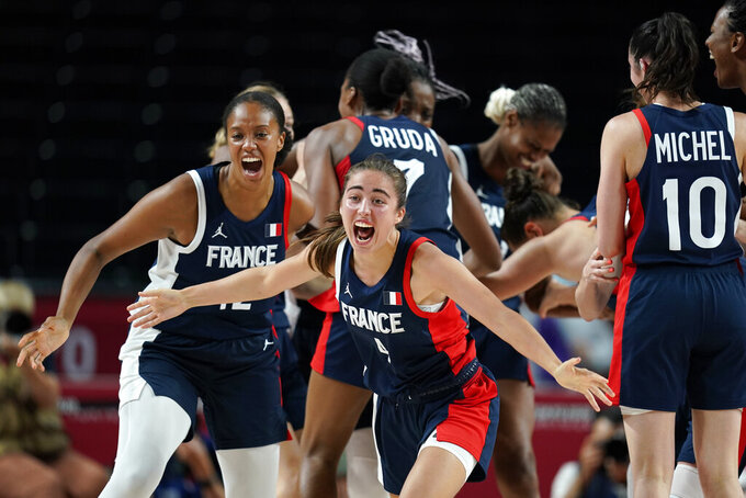 France's Marine Fauthoux (4) celebrates with teammates at the end of the women's basketball bronze medal game against Serbia at the 2020 Summer Olympics, Saturday, Aug. 7, 2021, in Saitama, Japan. (AP Photo/Charlie Neibergall)