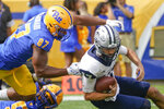 Pittsburgh defensive lineman Habakkuk Baldonado (87) sacks New Hampshire quarterback Bret Edwards (17) on the first play of the game in the first half of an NCAA college football game, Saturday, Sept. 25, 2021, in Pittsburgh. (AP Photo/Keith Srakocic)