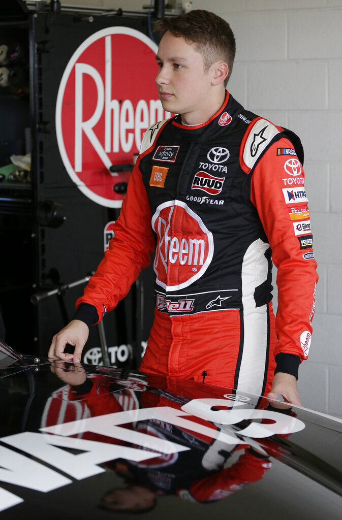 Christopher Bell stands by his car before a NASCAR Xfinity Series auto race practice on Friday, Nov. 15, 2019, at Homestead-Miami Speedway in Homestead, Fla. Bell is one of four drivers racing for the series championship. (AP Photo/Terry Renna)