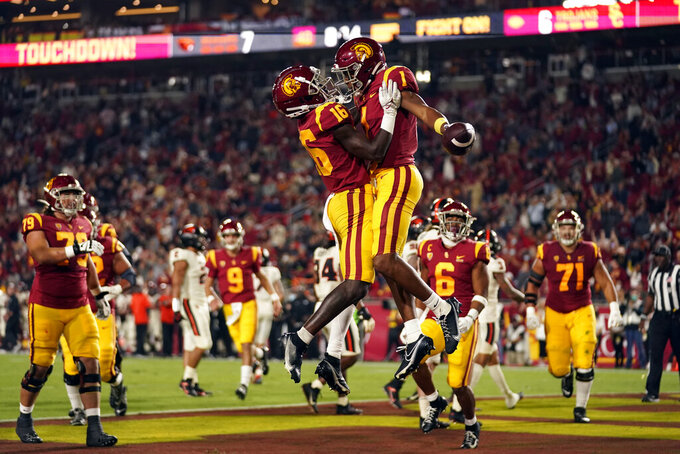 Southern California wide receiver Gary Bryant Jr. (1) celebrates his touchdown catch with wide receiver Tahj Washington (16) during the first half of an NCAA college football game against Oregon State, Saturday, Sept. 25, 2021, in Los Angeles. (AP Photo/Marcio Jose Sanchez)