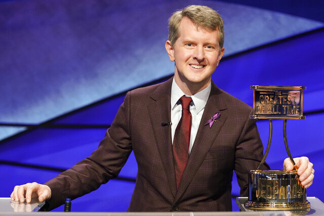 This image released by ABS shows contestant Ken Jennings with a trophy on
