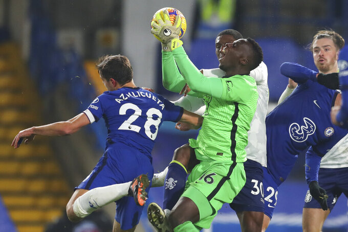 Chelsea's goalkeeper Edouard Mendy screams as he saves during the English Premier League soccer match between Chelsea and Aston Villa in London, England, Monday, Dec. 28, 2020. (Catherine Ivill/Pool via AP)