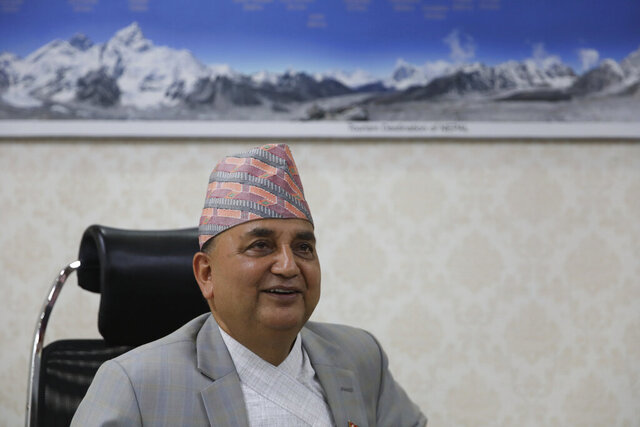Nepalese Deputy Prime Minister Ishwor Pokhrel speaks with the Associated Press during an interview at Singhadurbar in Kathmandu, Nepal, Thursday, June 25, 2020. Nepal's top official battling coronavirus said Thursday he was alert and aware of the increasing number of cases in neighboring India, but was prepared to face the flow of Nepalese workers returning home from India as the country's lockdown is eased. Deputy Prime Minister Ishwar Pokhrel told The Associated Press in an interview that coronavirus cases are expected to increase in Nepal as thousands of workers return home from neighboring India. (AP Photo/Bikram Rai)