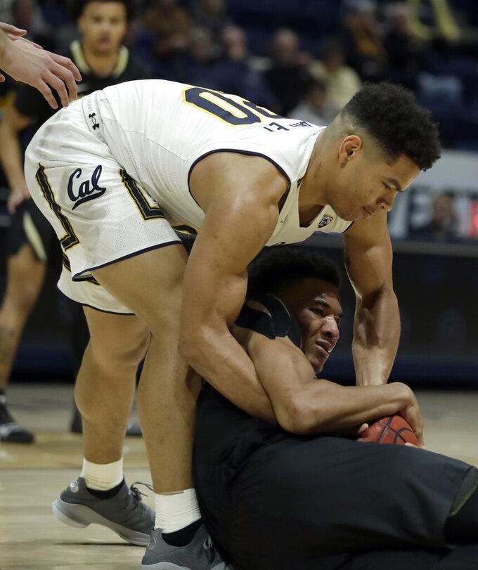 California's Matt Bradley, top, wrestles for the ball with Colorado's Tyler Bey during the first half of an NCAA college basketball game Thursday, Jan. 24, 2019, in Berkeley, Calif. (AP Photo/Ben Margot)