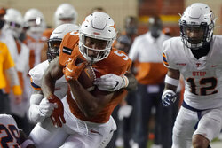 Texas's Bijan Robinson (5) runs after a catch against UTEP during the first half of an NCAA college football game in Austin, Texas, Saturday, Sept. 12, 2020. (AP Photo/Chuck Burton)