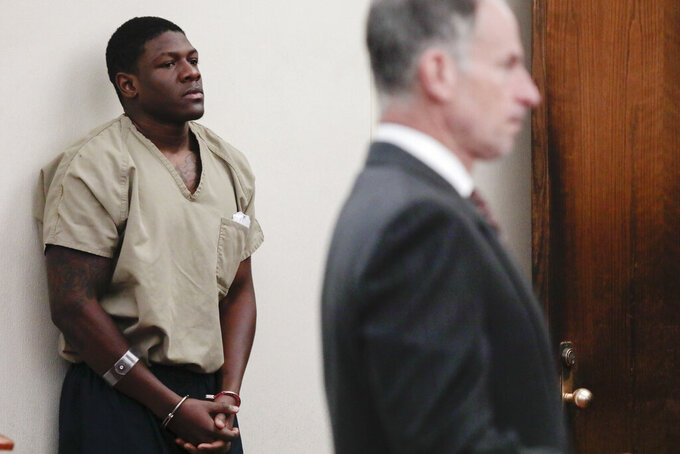 Former Ohio State football player Jahsen Wint listens as his attorney Sam Shamansky, right, speaks during his arraignment on Thursday, Feb. 13, 2020, at the Franklin County Municipal Courthouse in Columbus, Ohio. Wint, who was dismissed from the team on Feb. 12, 2020, along with teammate and co-defendant Amir Riep, are charged with the rape and kidnapping of a 19-year-old woman on Feb. 4, 2020 at an apartment the two men share. (Joshua A. Bickel/The Columbus Dispatch via AP)