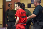 "ADDS ""SUSPECT"" - Parkland school shooting suspect Nikolas Cruz walks out of court after a hearing at the Broward Courthouse in Fort Lauderdale on Friday, March 22, 2019. (Taimy Alvarez/South Florida Sun-Sentinel via AP, Pool)"