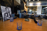 A table setting with photos and other memorabilia is viewed at Steve Spurrier's Gridiron Grill, Thursday, June 17, 2021, in Gainesville, Fla. The restaurant doubles as Spurrier's personal museum. (AP Photo/John Raoux)