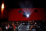 People watch a movie at a cinema after almost a year of theaters being closed due to the COVID-19 pandemic in Buenos Aires, Argentina, Wednesday, March 3, 2021. (AP Photo/Natacha Pisarenko)