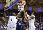 Duke's Zion Williamson, left, and RJ Barrett reach for the ball with Georgia Tech's James Banks III (1) during the second half of an NCAA college basketball game in Durham, N.C., Saturday, Jan. 26, 2019. Duke won 66-53. (AP Photo/Gerry Broome)