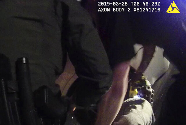 In this image made from a March 28, 2019, body-worn camera video provided by the Austin Police Department in Texas, Williamson County deputies hold down Javier Ambler as one of them uses a Taser on Ambler's back during his arrest in Austin, Texas. The black man died in custody in 2019 after sheriff's deputies repeatedly used stun guns on him, despite his pleas that he was sick and couldn't breathe, according a report published Monday, June 8, 2020, by the Austin American-Statesman and KVUE-TV. The video was made on the camera worn by an Austin police officer who also showed up at the scene as Williamson County deputies were making the arrest. (Austin Police Department via AP)