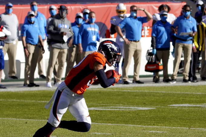 Denver Broncos free safety Justin Simmons (31) runs back an interception against the Los Angeles Chargers during the first half of an NFL football game, Sunday, Nov. 1, 2020, in Denver. (AP Photo/Jack Dempsey)