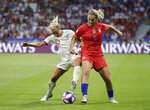 United States' Lindsey Horan, right, challenges for the ball with England's Rachel Daly during the Women's World Cup semifinal soccer match between England and the United States, at the Stade de Lyon, outside Lyon, France, Tuesday, July 2, 2019. (AP Photo/Alessandra Tarantino)