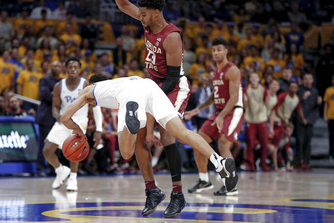 Pittsburgh's Trey McGowens, left, is fouled by Florida State's M.J. Walker (23) during the first half of an NCAA college basketball game Wednesday, Nov. 6, 2019, in Pittsburgh. (AP Photo/Keith Srakocic)