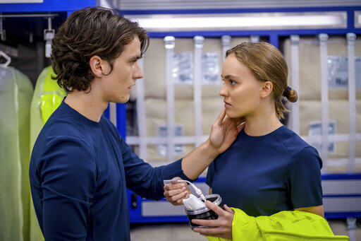 """This image released by Lionsgate shows Fionn Whitehead, left, and Lily-Rose Depp in a scene from """"Voyagers."""" (Vlad Cioplea/Lionsgate via AP)"""