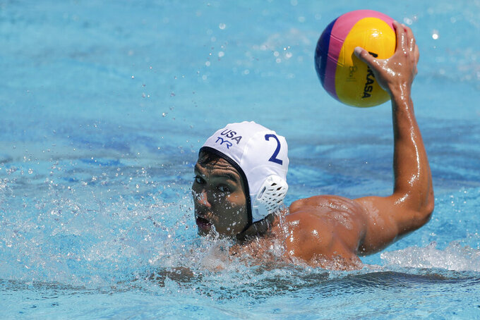 FILE - U.S. men's national water polo player Johnny Hooper prepares to shoot during a training session in Torrance, Calif, in this Monday, July 1, 2019, file photo. Hooper is among 18 U.S. men's water polo players who joined professional teams in Europe after COVID-19 hampered their training in California.  (AP Photo/Chris Carlson, File)