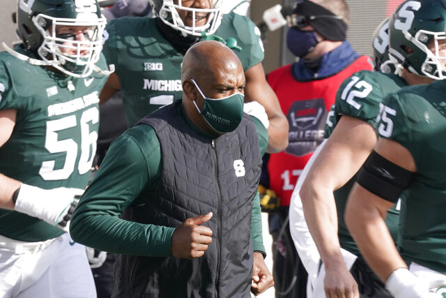 FILE - Michigan State head coach Mel Tucker runs onto the field before the first half of an NCAA college football game against Indiana in East Lansing, Mich., in this Saturday, Nov. 14, 2020, file photo. In a season of video conferences and empty seats, new Michigan State coach Mel Tucker is doing his best to help people get to know him. (AP Photo/Carlos Osorio, File)