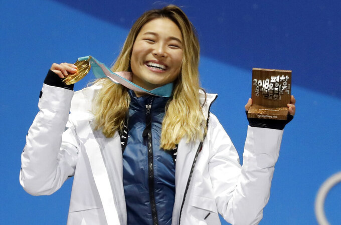 FILE - In this Feb. 13, 2018, file photo, women's halfpipe gold medalist ChloeKim, of the United States, poses during the medals ceremony at the 2018 Winter Olympics in Pyeongchang, South Korea. Chloe Kim took some time off to heal her body and broaden her mind. Mission(s) accomplished, and now that she's back at her day job — best female athlete in the halfpipe — it looks as though she never left. Now 20 and with a year at Princeton under her belt, the Olympic champion is in the lineup for the Winter X Games, going for her fifth gold medal on the superpipe in Aspen on Saturday night, Jan. 30, 2021. (AP Photo/Morry Gash, File)