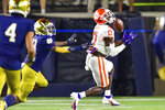 Clemson wide receiver Cornell Powell (17) catches a pass for a touchdown as Notre Dame cornerback TaRiq Bracy (28) defends during the first quarter of an NCAA college football game Saturday, Nov. 7, 2020, in South Bend, Ind. (Matt Cashore/Pool Photo via AP)