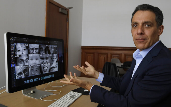 In this Monday, July 1, 2019, photo Hany Farid, a digital forensics expert at the University of California at Berkeley, gestures as he views video clips in his office in Berkeley, Calif. Dumb fakes, shallow fakes and cheap fakes, experts are still undecided on how to label the poorly made manipulated videos being viewed millions of times and even spread by high-ranking politicians. But they are sure that social media users will see much more of these videos ahead of the U.S. 2020 presidential elections. (AP Photo/Ben Margot)