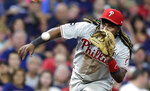 Philadelphia Phillies' Maikel Franco fields a ball hit by Cleveland Indians' Roberto Perez during the seventh inning in a baseball game, Friday, Sept. 20, 2019, in Cleveland. Perez was out on the play. (AP Photo/Tony Dejak)