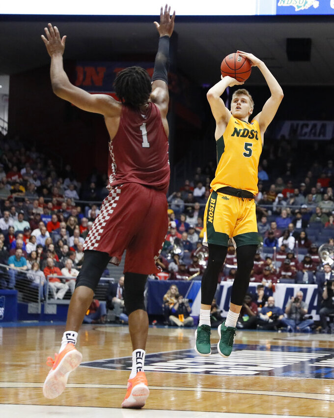 North Dakota State's Sam Griesel (5) shoots over North Carolina Central's Zacarry Douglas (1) during the second half of a First Four game of the NCAA men's college basketball tournament Wednesday, March 20, 2019, in Dayton, Ohio. (AP Photo/John Minchillo)