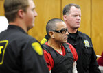 FILE - In this Nov. 17, 2011 file photo, Vagos motorcycle gang member Ernesto Gonzalez is led from district court under heavy security in Reno, Nev., after pleading guilty in the shooting death of Hells Angels member Jeffrey