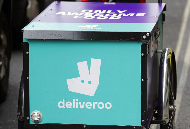 FILE - In this Tuesday July 11, 2017 file photo, a Deliveroo logo on a bicycle in London. British regulators said Friday Dec. 27, 2019, they are launching a full-scale investigation of Amazon's plan to purchase a stake in Deliveroo to determine if it would dampen competition. (AP Photo/Frank Augstein, File)