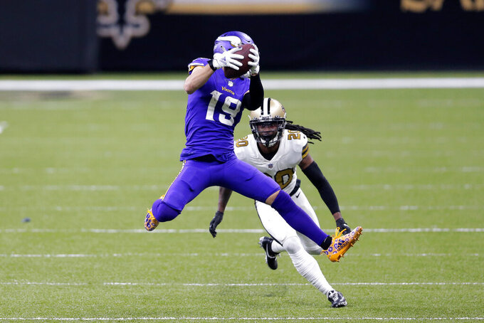 Minnesota Vikings wide receiver Adam Thielen (19) pulls in a pass in front of New Orleans Saints cornerback Janoris Jenkins (20) in the second half of an NFL football game in New Orleans, Friday, Dec. 25, 2020. (AP Photo/Brett Duke)