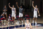 Liberty players celebrate a successful three-point basket by a teammate during an NCAA college basketball game against North Alabama in Lynchburg, Va., Monday, Feb. 22, 2021. (Kendall Warner/The News & Advance via AP)