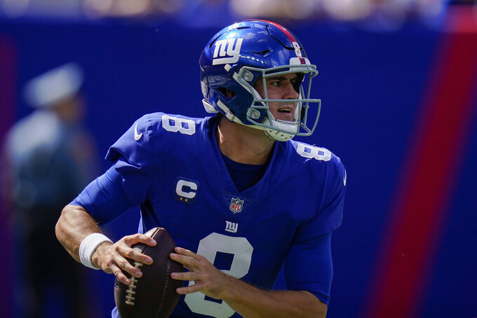 New York Giants quarterback Daniel Jones looks to pass during the first half of an NFL football game against the Atlanta Falcons, Sunday, Sept. 26, 2021, in East Rutherford, N.J. (AP Photo/Seth Wenig)