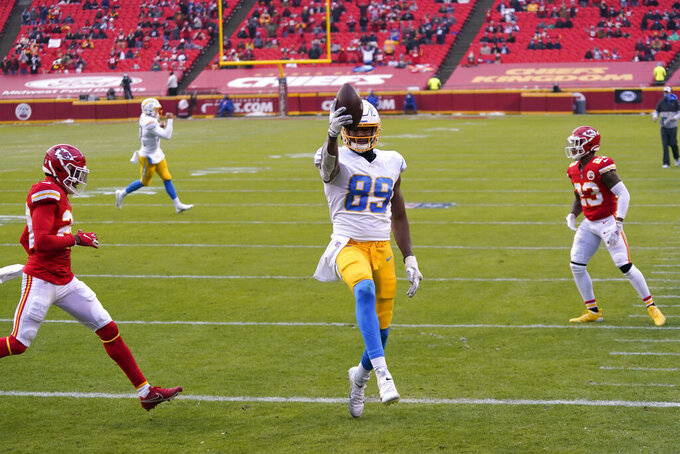 Los Angeles Chargers tight end Donald Parham Jr. (89) celebrates after catching an 8-yard touchdown pass during the first half of an NFL football game against the Kansas City Chiefs, Sunday, Jan. 3, 2021, in Kansas City. (AP Photo/Jeff Roberson)